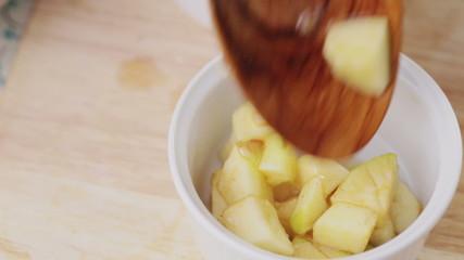 Filling Ramekin with Apples