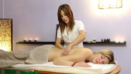beautiful blonde woman relaxes during massage at the health spa