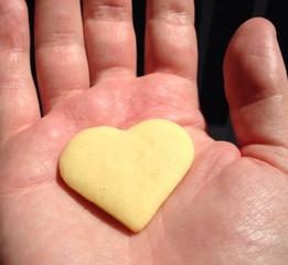 heart cookie in hand