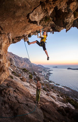Seven-year old girl climbing a challenging route