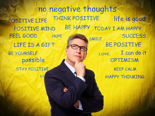 Positive thinking man over abstract background.
