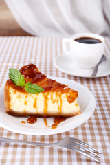 Cheese cake and cup of coffee