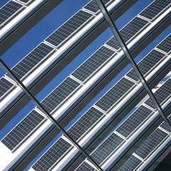Solar Panels Against The Deep Blue Sky