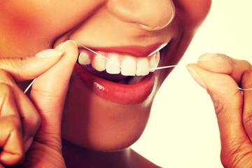 Young woman with dental floss.