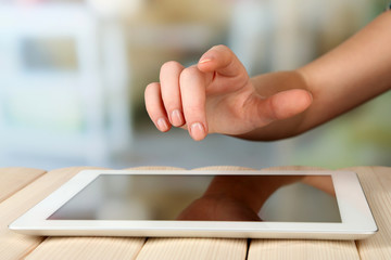 Hand using tablet PC