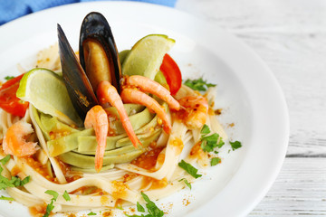 Tasty pasta with shrimps, mussels and tomatoes