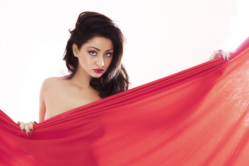 Woman with seductive look holding red cloth