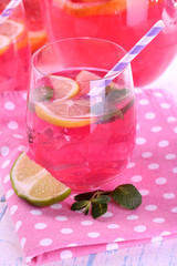 Pink lemonade in glasses on table close-up