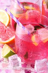 Pink lemonade in glasses on bright background