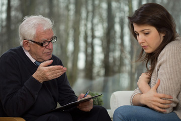 Senior psychotherapist and young patient