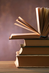 Books with light over dark background
