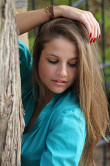A portrait of a beautiful young woman outdoors