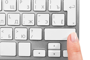 Female finger with keyboard on white background