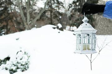 Hanging lantern on snowfall background