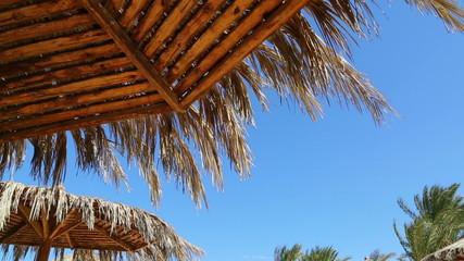 Beach umbrella against blue sky