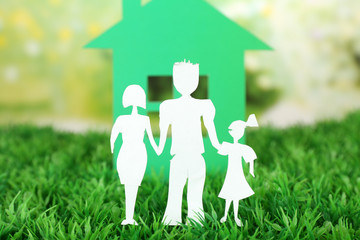 Cutout paper family and house