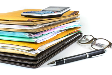 Stack of document with pen and calculator