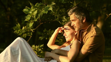 Couple enjoying sunset in the park outdoor