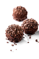 chocolates with crumbs close-up on white background