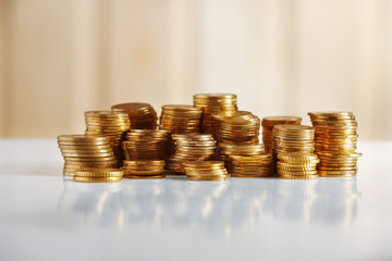 Pile of coins on light background