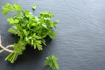 Green parsley on dark slate