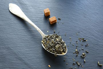 Chinese green tea with slices of sugar on the boards