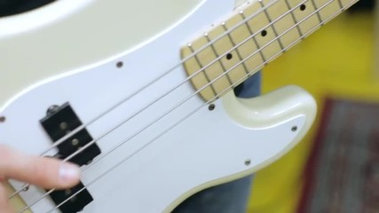 Close-up of a bass -bassist - bass player - playing electric bass