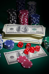 Stack of dollars dices and chips