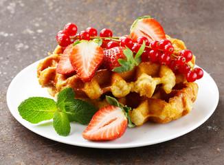 homemade Belgian waffles with berries (strawberries)