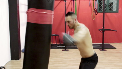 boxer trains with the punching bag - boxe