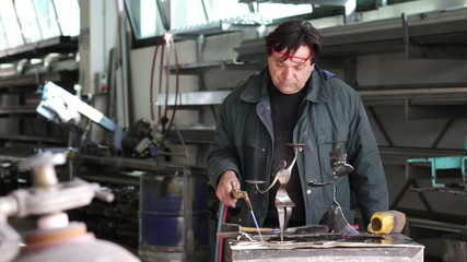 craftsman in wrought iron - dolly