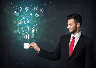 Businessman holding a white cup with business icons