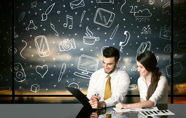 Business couple with social media symbols
