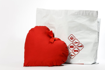 Heart with ribbon and courier symbol icons