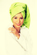 Attractive woman in bathrobe and turban on head