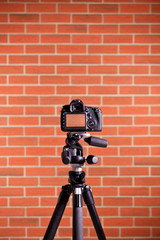 DSLR Camera on tripod shooting brick wall