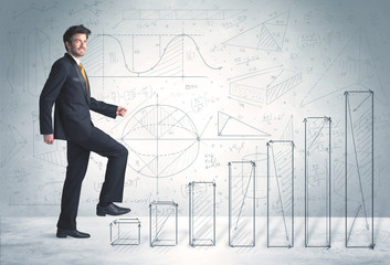 Business man climbing up on hand drawn graphs concept