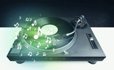Turntable playing music with audio notes glowing