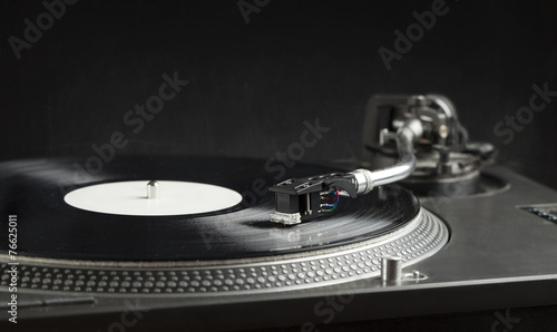 Leinwanddruck Bild Turntable playing vinyl close up with needle on the record