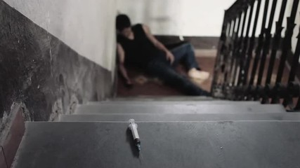 man dies at the end of stairs for a heroin dose - addict - drug