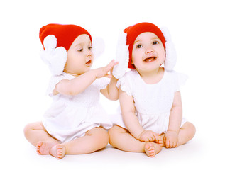 Two twins baby in hats playing