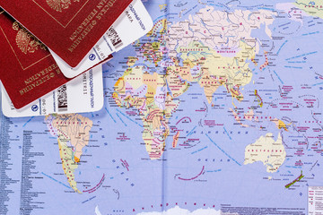 open world map with passports and tickets