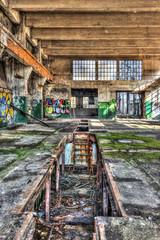 Inspection pit in a derelict workshop