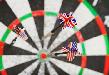 old perforation dartboard with flags on darts