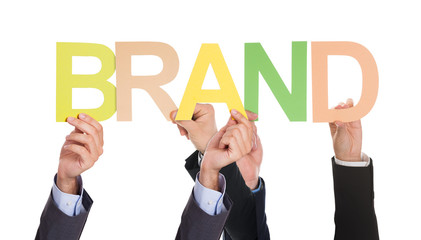 Businesspeople Hand With The Word Brand