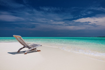 Beach view of amazing water in Maldives - empty chair