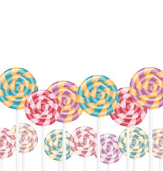 Multicolored lollipops on white background