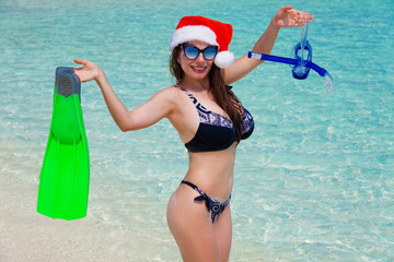 Maldives, women, flippers, mask and tube, christmas hat
