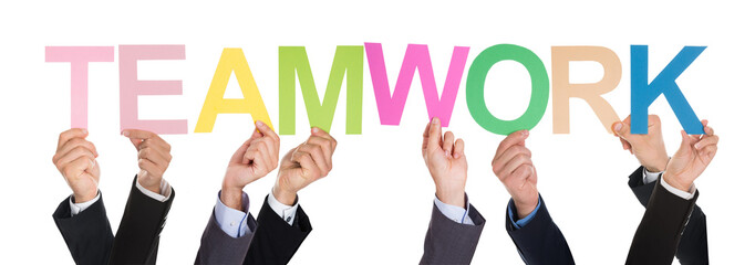 Businesspeople Holding The Word Teamwork
