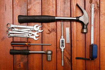 Tools on wood background